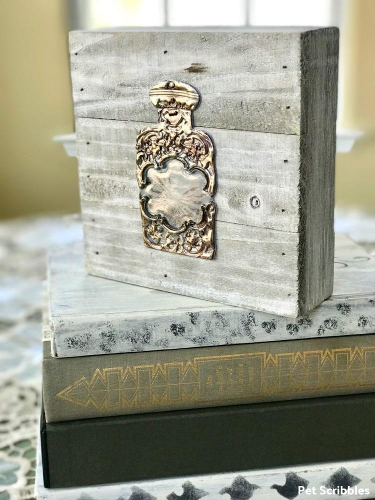 vintage perfume bottle on wood