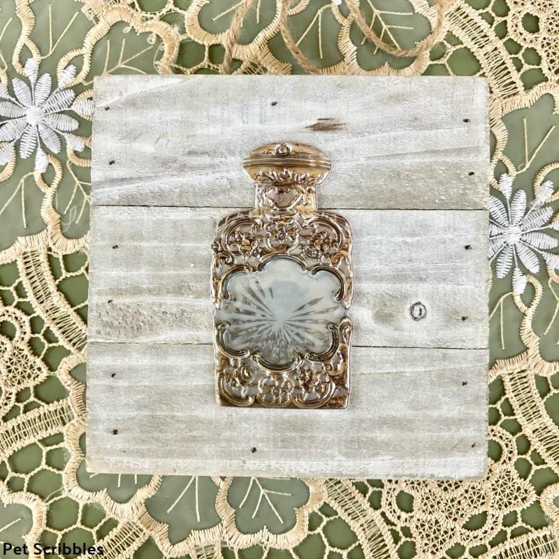 vintage perfume bottle wall art