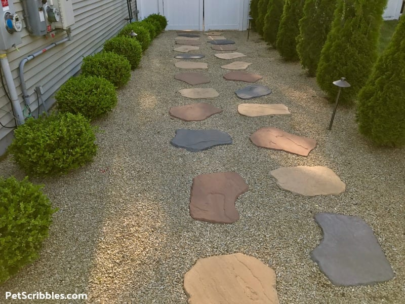 no grass side yard using decorative gravel and pavers