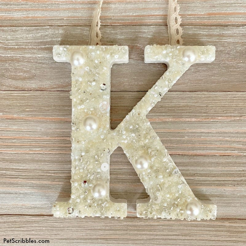 letter K covered in pearls and seed beads