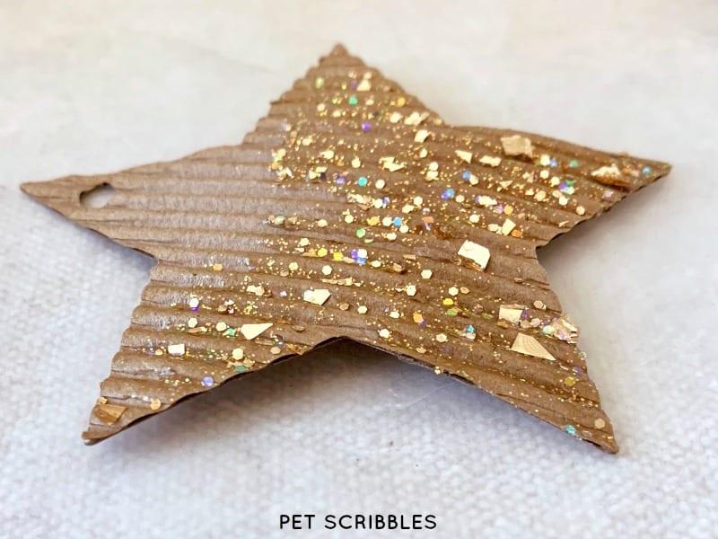 making glitter cardboard star ornaments