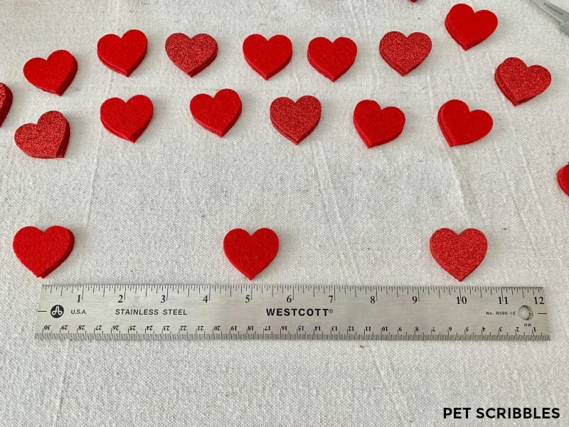 measuring out hearts for felt heart garland
