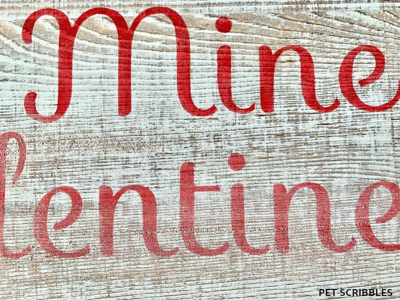 sanding a rustic Valentine's Day sign
