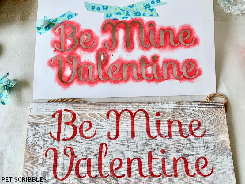 stenciling a rustic wood Valentine's Day sign