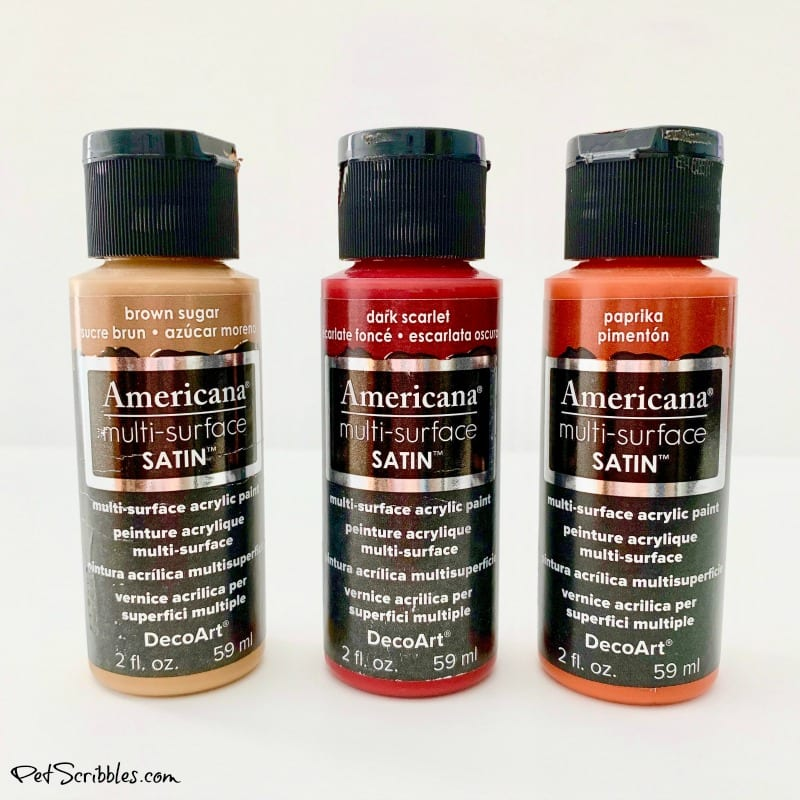 three bottles of DecoArt brand multi-surface craft paint