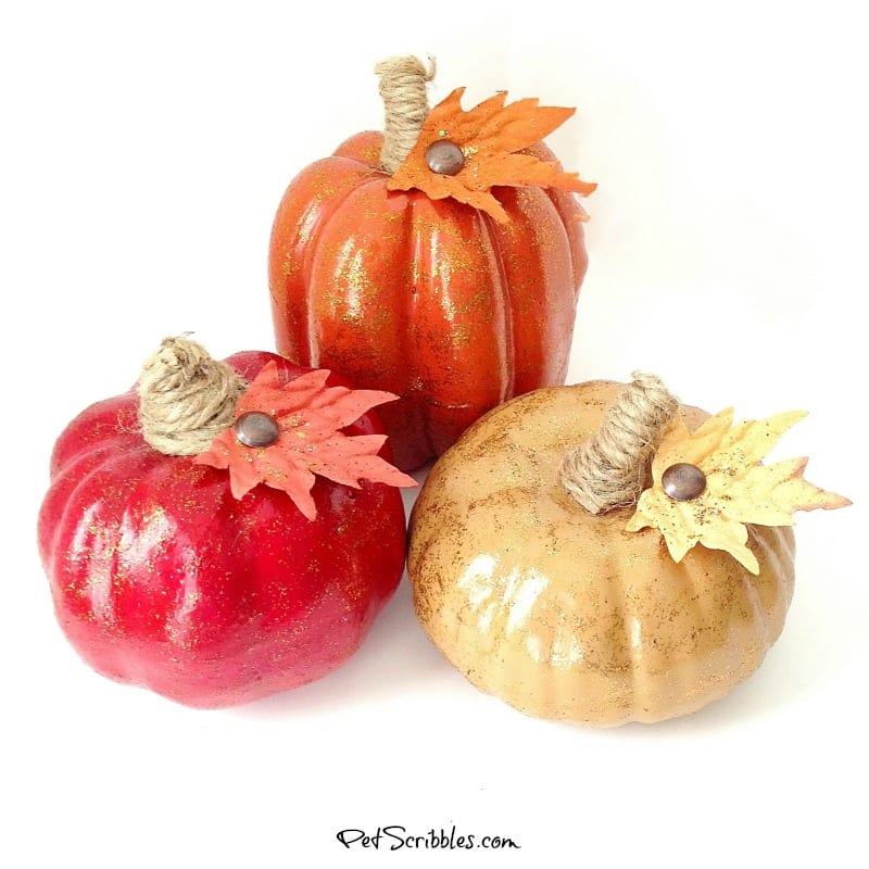 tone on tone painted and glittered dollar store pumpkins