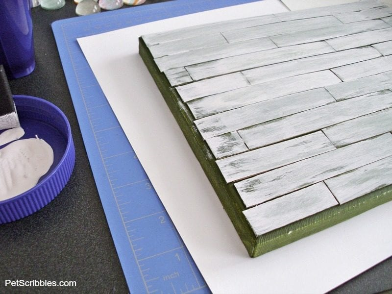 layering paint colors on a canvas