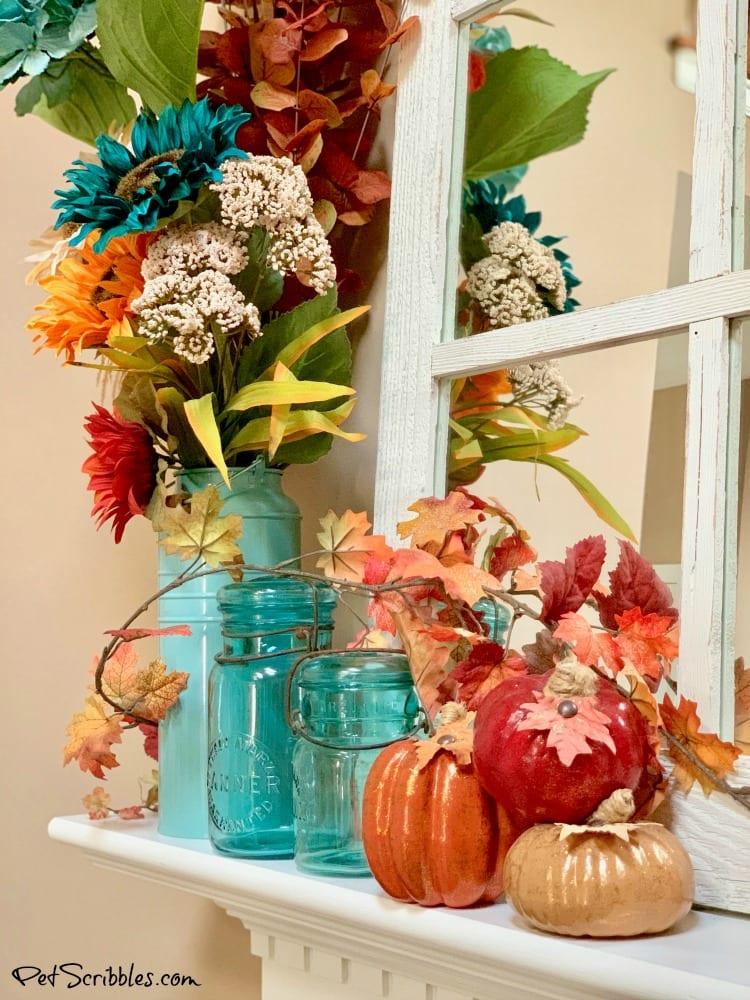 Fall mantel with antique mason jars and pumpkins