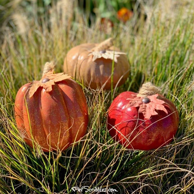 glittered pumpkins and ornamental grasses