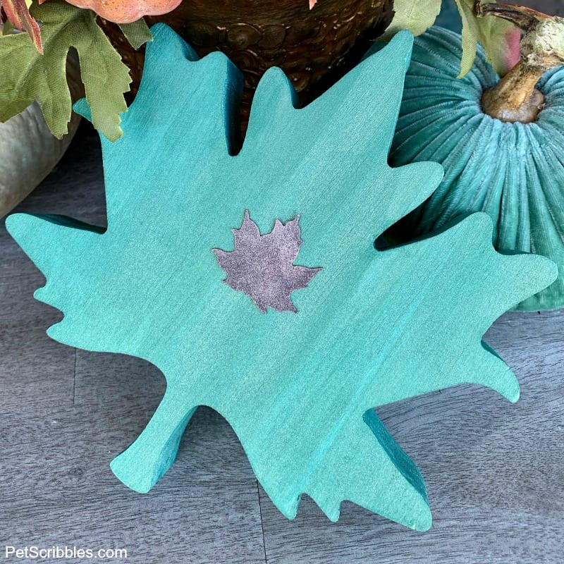 teal painted wooden leaf