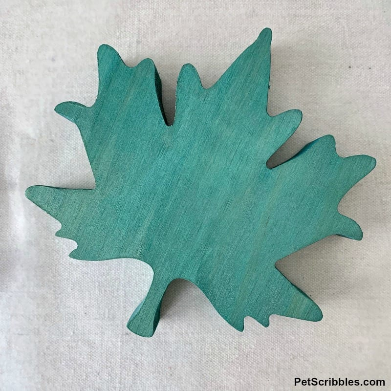 teal painted wooden leaves