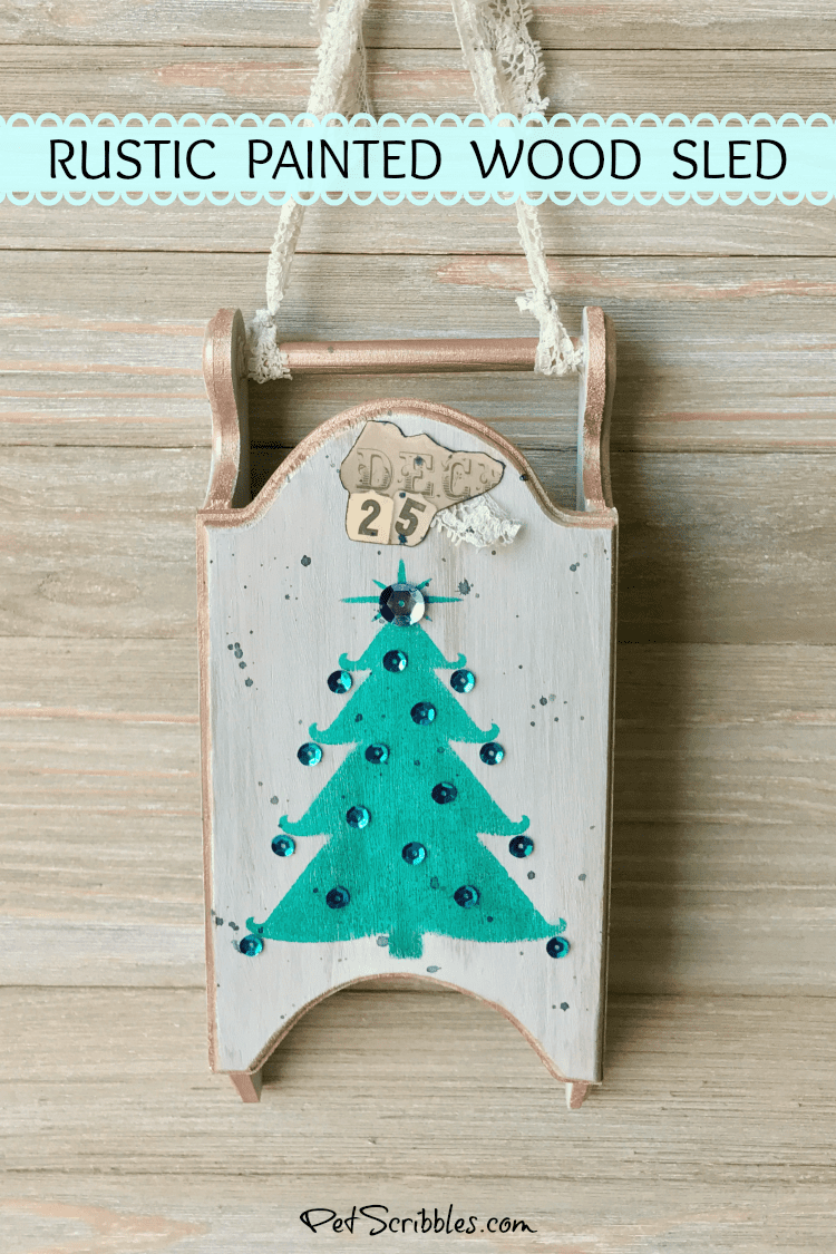 a rustic painted wood sled for Christmas