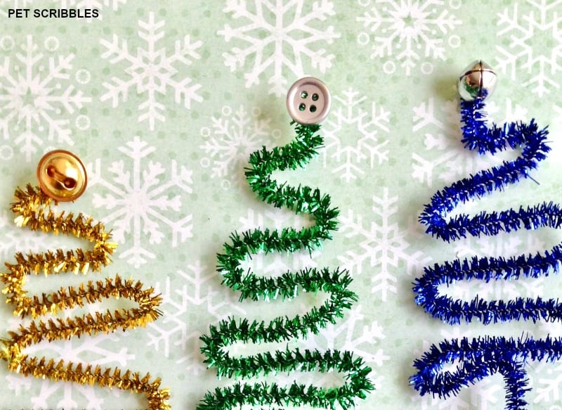 use jingle bells or buttons as the tree toppers
