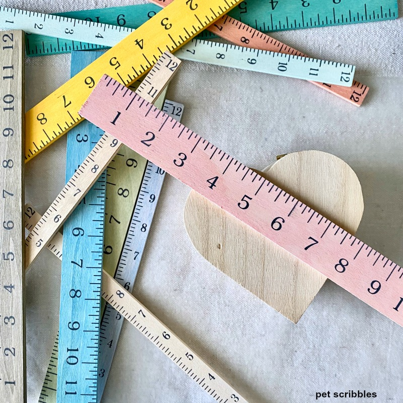 wooden rulers stained with pickling wash colors