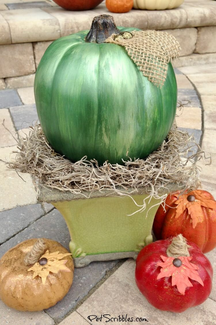 DIY mercury glass pumpkin with green shades of metallic paint