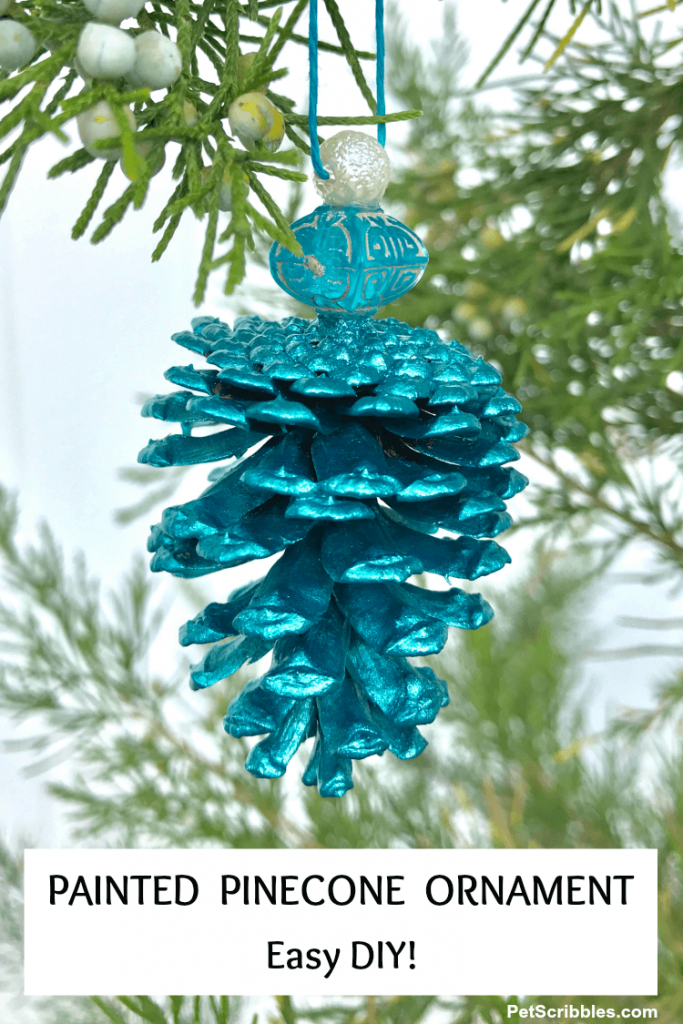 pretty painted pinecone ornament in teal