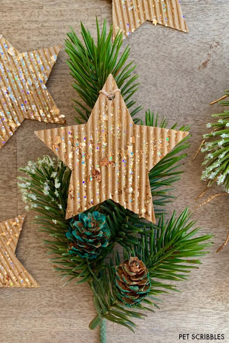 corrugated cardboard glitter star ornament on holiday greenery