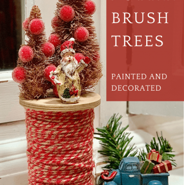 rustic bottle brush trees on a large spool