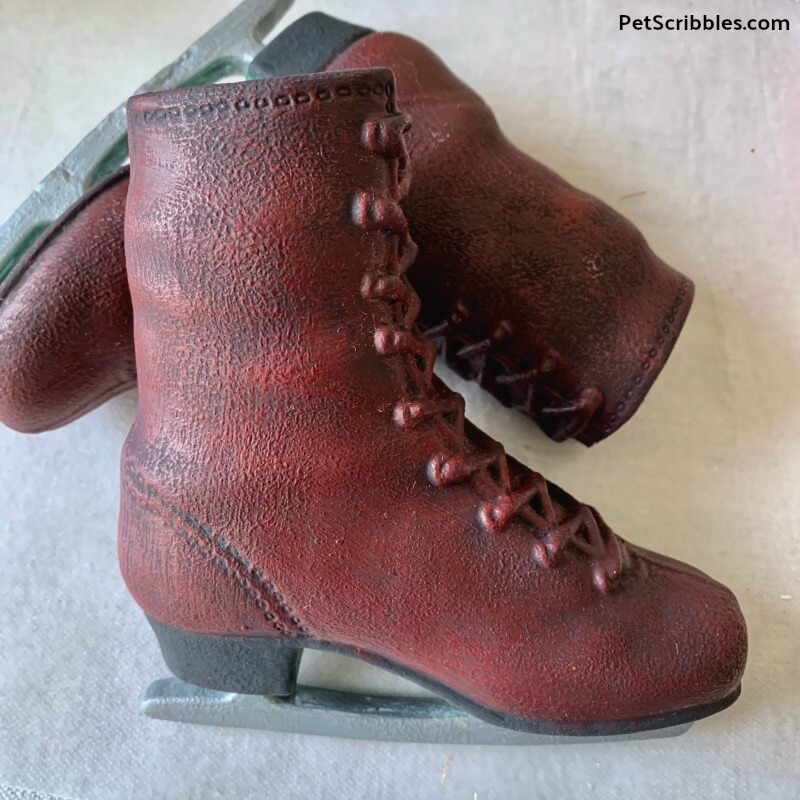 distressed red painted ice skates