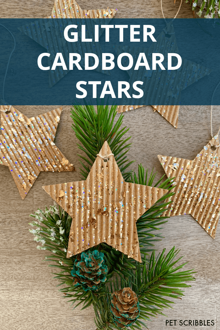 glitter cardboard star ornaments and decorative holiday greenery
